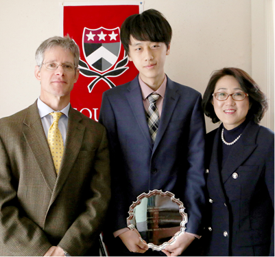 HEAD OF SCHOOL ANDREW VADNAIS, TAEK GI WITH HIS AWARD, AND DR. LEE.