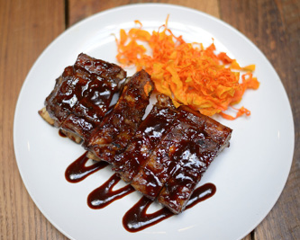 THEIR POPULAR KOREAN BBQ SPARE RIBS. MIKE YAMIN
